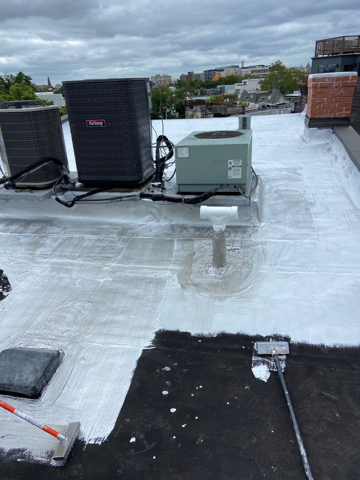 Flat rubber roof being coated