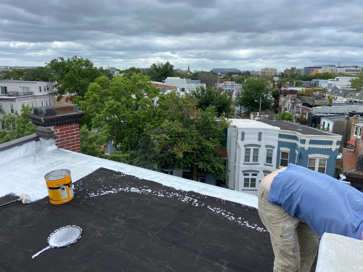 Rubber roof being coated