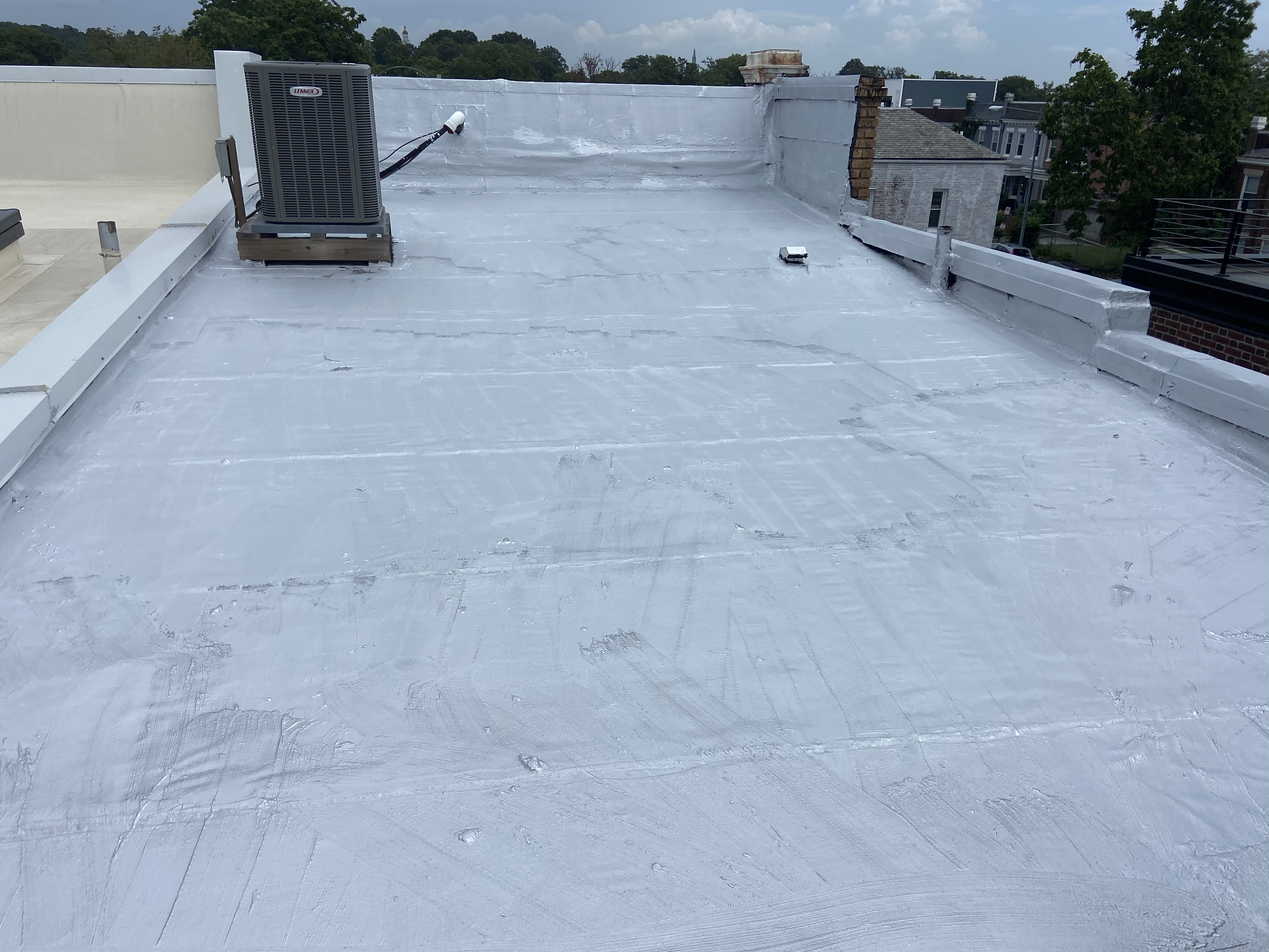 Coated rubber roof